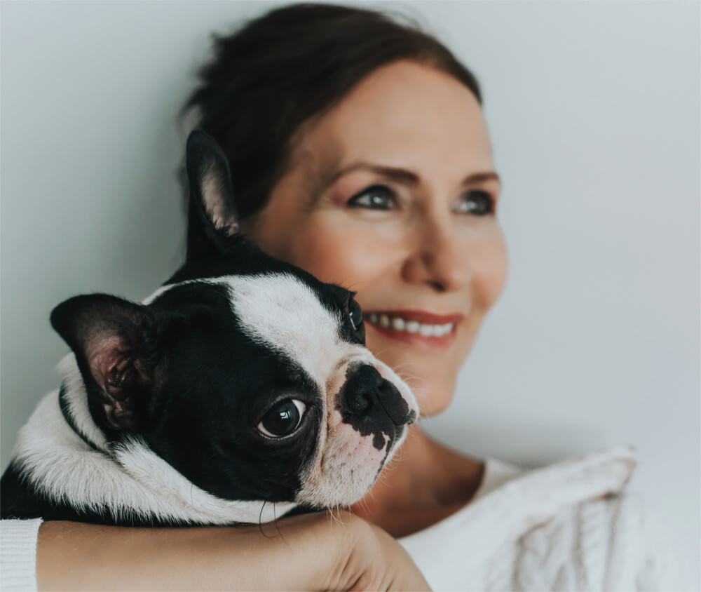 shutterstock_1179024172 woman with pug-1000